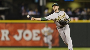 He's back in Oakland, but it looks like it could be a long year for Jed Lowrie and the A's. (Steven Bisig-USA TODAY Sports)
